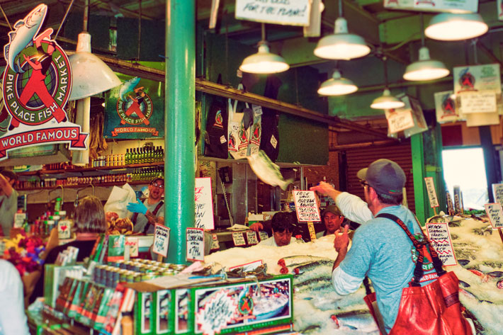 World famous Seattle Pike Place Fish market throwing fish